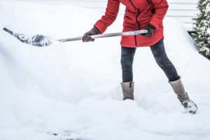 Close-up of Woman Shoveling her Parking lot after Snowstorm