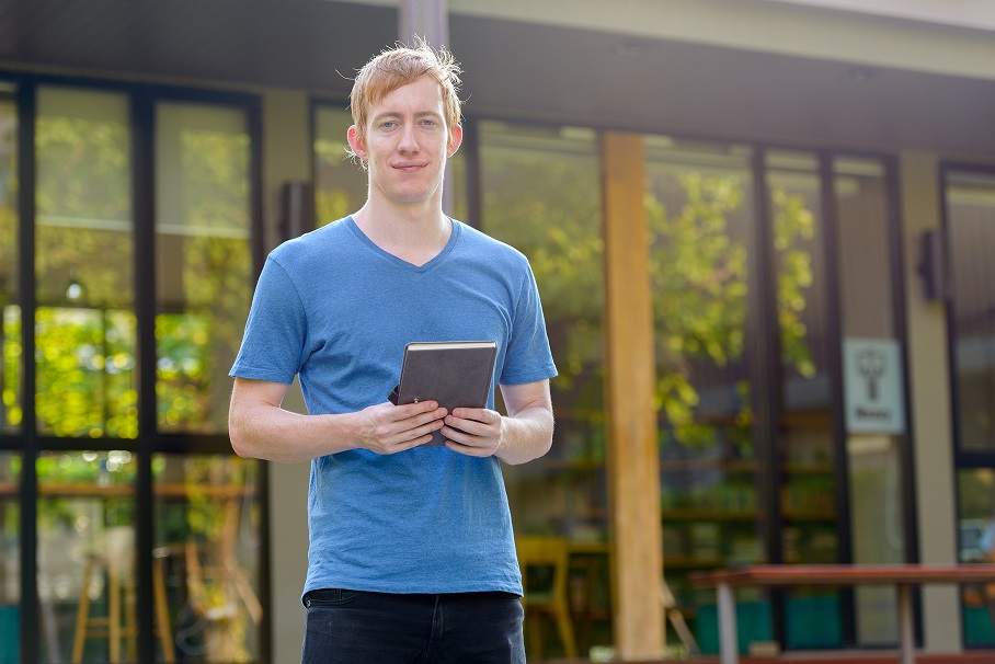 Portrait of man with red hair in the garden outdoors