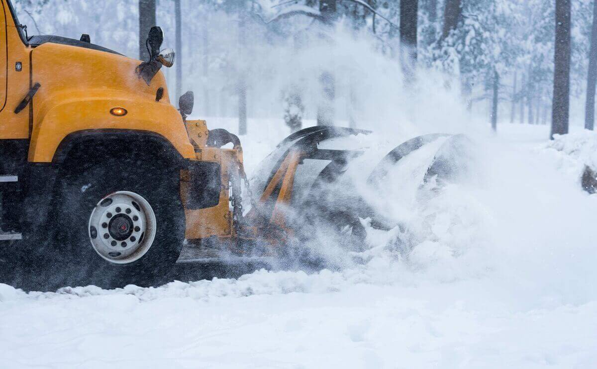 snow removal company's snow plow at work